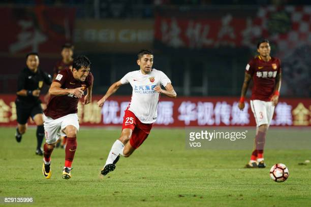 Odil Ahmedov of Shanghai SIPG vies for the ball during the 21st round match of 2017 China Super League between Hebei China Fortune FC and Shanghai...