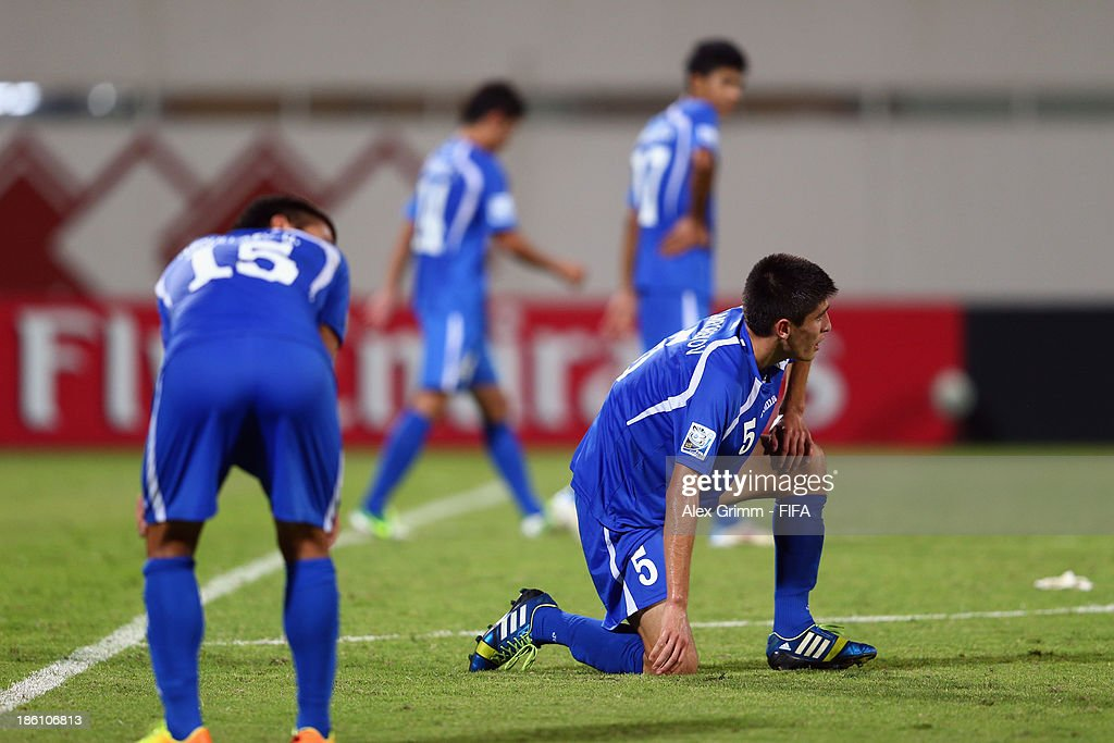 Odiljon Hamrobekov #5 of Uzbekistan and team mates react after Jorge Bodden of Honduras scored his team's first goal during the FIFA U-17 World Cup UAE 2013 Round of 16 match between Honduras and Uzbekistan at Sharjah Stadium on October 28, 2013 in Sharjah, United Arab Emirates.
