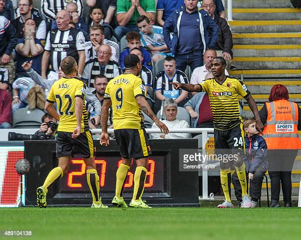 Odio Ighalo of Watford celebrates with teammates Almen Abdi and Troy Deeney after scoring their second goal during the Barclays Premier League match...