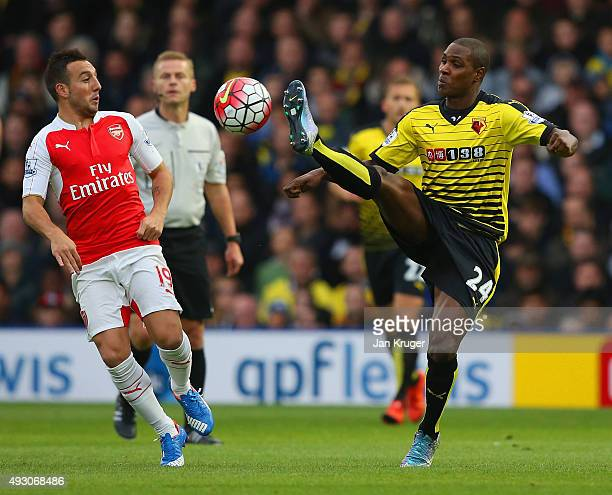 Odion Ighalo of Watford and Santi Cazorla of Arsenal compete for the ball during the Barclays Premier League match between Watford and Arsenal at...