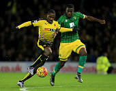 Odion Ighalo of Watford and Sebastien Bassong of Norwich City compete for the ball during the Barclays Premier League match between Watford and...
