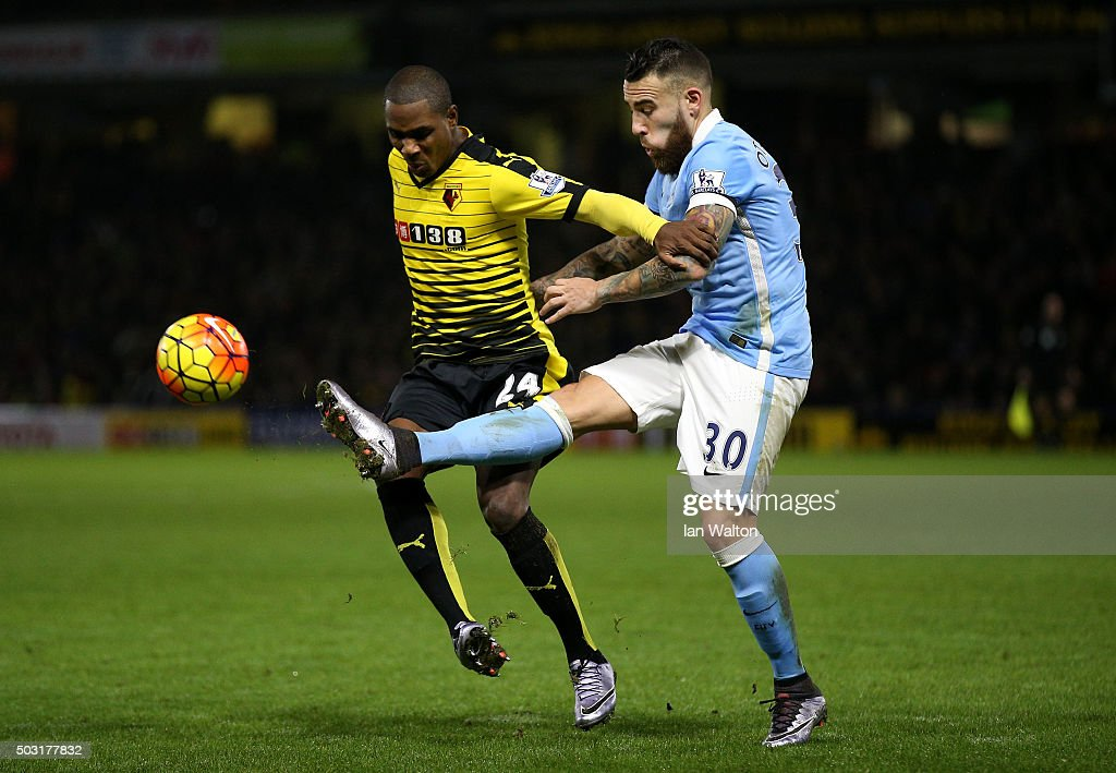 Odion Ighalo of Watford battles for the ball with Nicolas Otamendi of Manchester City during the Barclays Premier League match between Watford and Manchester City at Vicarage Road on January 2, 2016 in Watford, England.