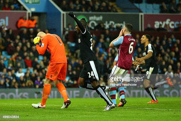 Odion Ighalo of Watford celebrates his team's second goal while Aston Villa players show their dejection after Alan Hutton of Aston Villa scored an...