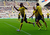 Odion Ighalo of Watford celebrates scoring his team's first goal with his team mates during the Barclays Premier League match between Newcastle...