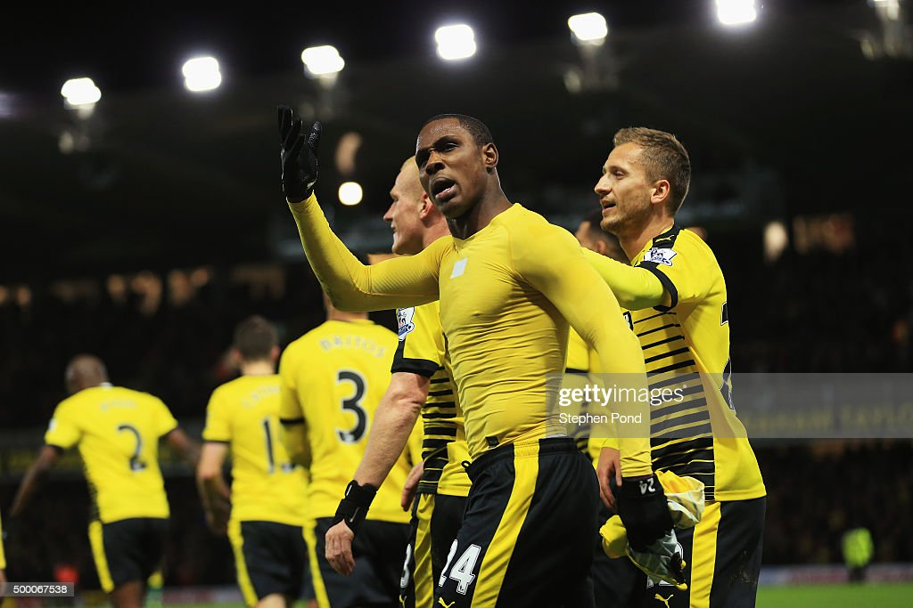 Odion Ighalo of Watford celebrates scoring his team's second goal with his team mates during the Barclays Premier League match between Watford and...