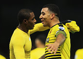 Odion Ighalo of Watford celebrates scoring his team's second goal with his team mate Troy Deeney during the Barclays Premier League match between...