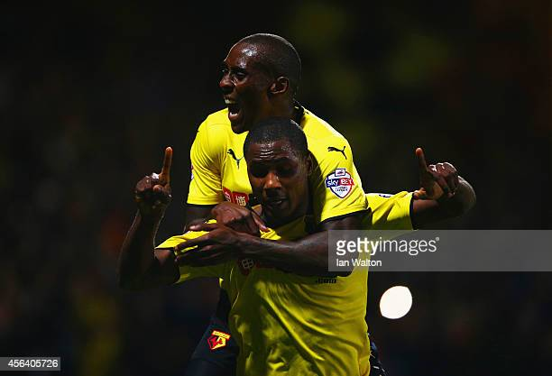 Odion Ighalo of Watford celebrates with Lloyd Dyer as he scores their first goal during the Sky Bet Championship match between Watford and Brentford...