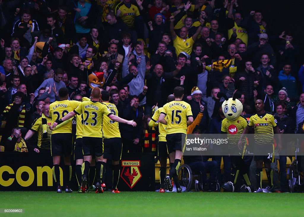 Odion Ighalo of Watford celebrates with team mates and mascot Harry the Hornet as he scores their third goal during the Barclays Premier League match...