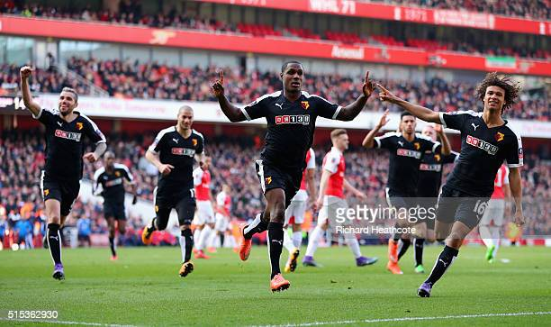 Odion Ighalo of Watford celebrates with team mates as he scores their first goal during the Emirates FA Cup sixth round match between Arsenal and...
