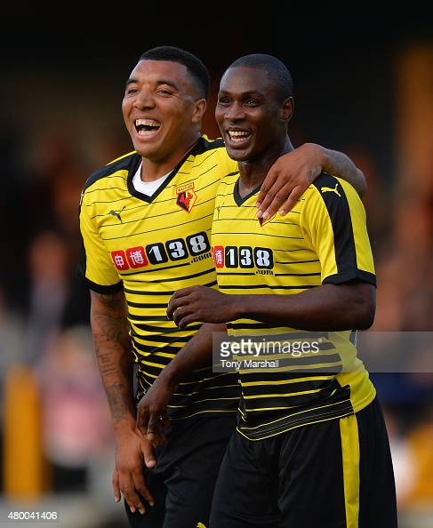 Odion Ighalo of Watford celebrates with Troy Deeney after scoring their second goal during the Pre Season Friendly match between St Albans City and...