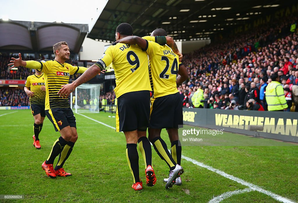 Odion Ighalo of Watford celebrates with Troy Deeney and team mates as he scores their second goal during the Barclays Premier League match between...