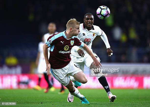 Odion Ighalo of Watford closes down Ben Mee of Burnley during the Premier League match between Burnley and Watford at Turf Moor on September 26 2016...