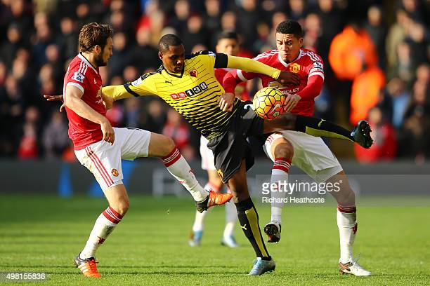 Odion Ighalo of Watford competes for the ball against Daley Blind and Chris Smalling of Manchester United during the Barclays Premier League match...