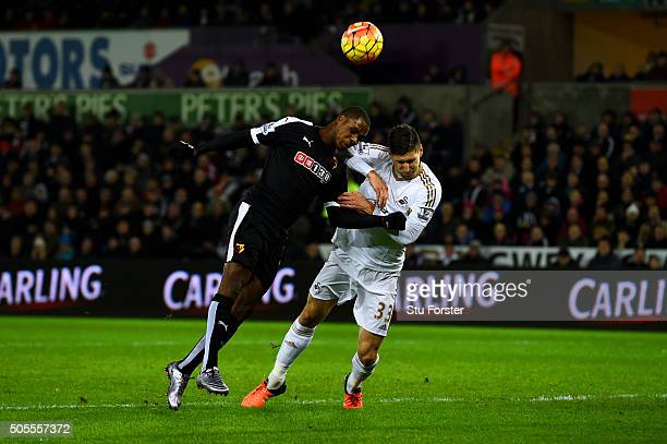 Odion Ighalo of Watford heads wide under pressure from Federico Fernandez of Swansea City during the Barclays Premier League match between Swansea...