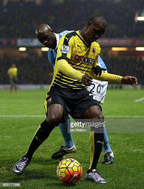 Odion Ighalo of Watford holds off Eliaquim Mangala of Manchester City during the Barclays Premier League match between Watford and Manchester City at...