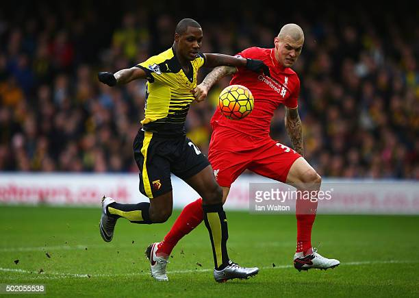 Odion Ighalo of Watford holds off Martin Skrtel of Liverpool as he scores their second goal during the Barclays Premier League match between Watford...