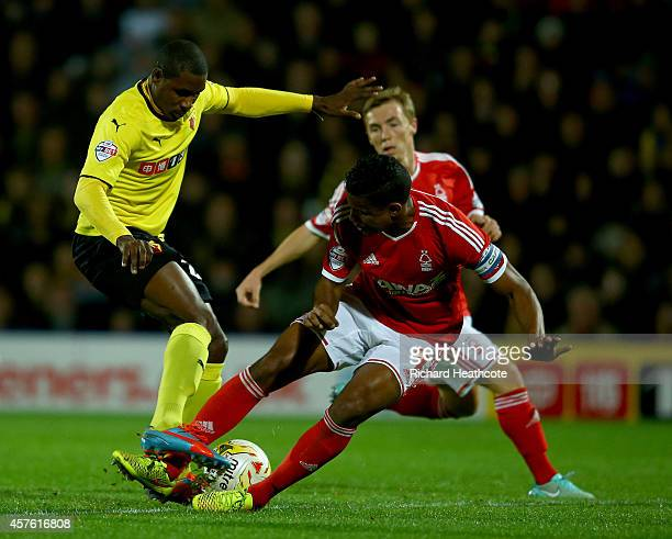 Odion Ighalo of Watford is tackled by Michael Mancienne of Forest during the Sky Bet Championship match between Watford and Nottingham Forest at...