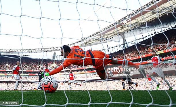 Odion Ighalo of Watford scores their first goal past goalkeeper David Ospina of Arsenal during the Emirates FA Cup sixth round match between Arsenal...