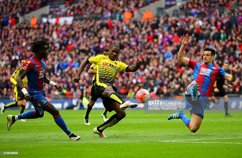Odion Ighalo of Watford shoots past Scott Dann of Crystal Palace during The Emirates FA Cup semi final match between Watford and Crystal Palace at Wembley Stadium on April 24, 2016 in London, England.