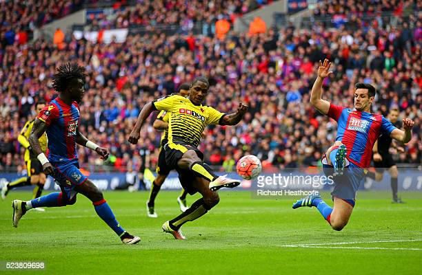 Odion Ighalo of Watford shoots past Scott Dann of Crystal Palace during The Emirates FA Cup semi final match between Watford and Crystal Palace at...