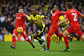 Odion Ighalo of Watford takes on Alberto Moreno Lucas Leiva and Nathaniel Clyne of Liverpool during the Barclays Premier League match between Watford...