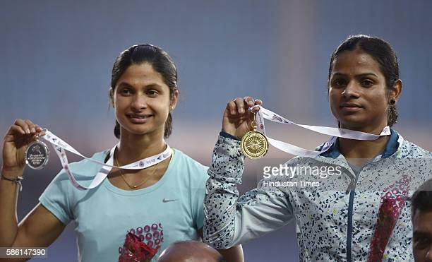 Odisha athletes Dutee Chand with Gold medal and Srabani Nanda with Silver Medal winning of Women 100m event during the 20th Federation Cup senior...