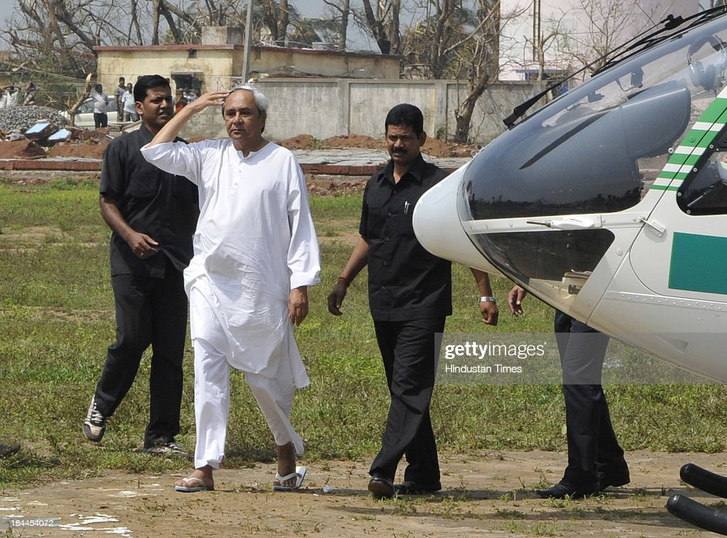 Odisha Chief Minister Naveen Patnaik coming out of chopper after aerial survey of the Phailin affected Ganjam district on October 14, 2013 in Chattarpur, India. 23 people were killed by Cyclone Phailin and the storm affected nearly 90 lakh people and destroyed paddy crops worth about Rs 2,400 crore.