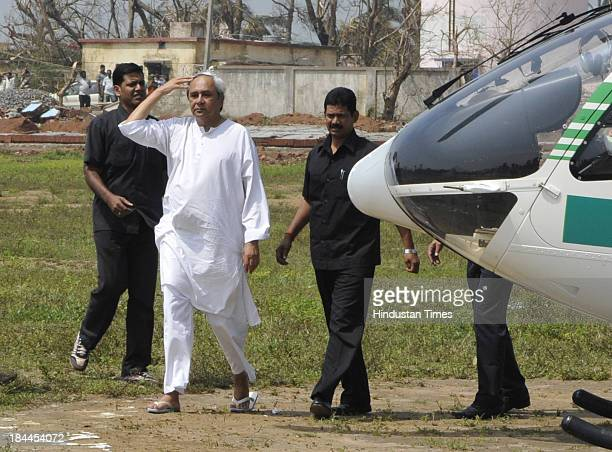 Odisha Chief Minister Naveen Patnaik coming out of chopper after aerial survey of the Phailin affected Ganjam district on October 14 2013 in...