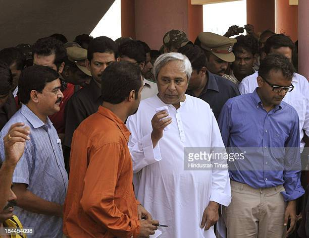 Odisha Chief Minister Naveen Patnaik talking with the journalist during visit to meet victim villagers at the multipurpose cylone shelter at...