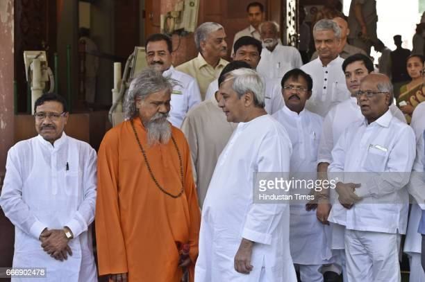 Odisha Chief Minister Naveen Patnaik with party MPs on his arrival at Parliament during the second leg of Budget Session on April 10 2017 in New...