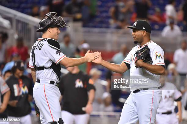 Odrisamer Despaigne of the Miami Marlins is congratulated by catcher JT Realmuto after defeating the San Francisco Giants at Marlins Park on August...