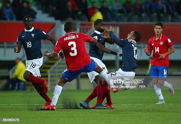 Odsonne Edouard and Bilal Boutobba of France collide near midfield as Pablo Arboine of Costa Rica plays the ball during the France v Costa Rica Round...