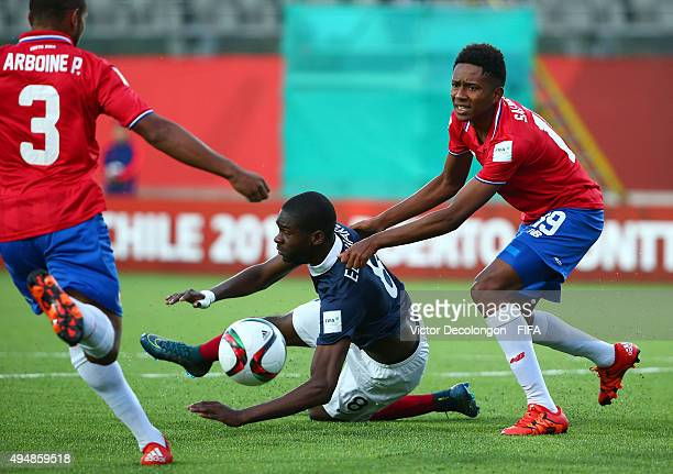 Odsonne Edouard of France falls to the pitch as Yostin Salinas of Costa Rica looks to the official during the France v Costa Rica Round of 16 FIFA...