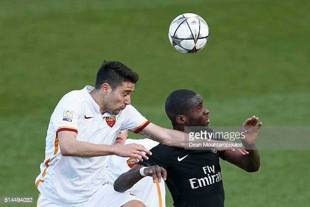 Odsonne Edouard of PSG battles for the ball with Riccardo Marchizza of Roma during the UEFA Youth League Quarterfinal match between Paris Saint...