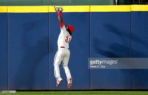 Odubel Herrera of the Philadelphia Phillies catches a deep fly ball by Jonny Gomes of the Atlanta Braves in the sixth inning at Turner Field on May 4...