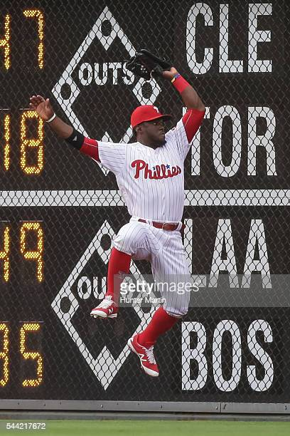 Odubel Herrera of the Philadelphia Phillies catches a fly ball against the fence in the third inning during a game against the Kansas City Royals at...
