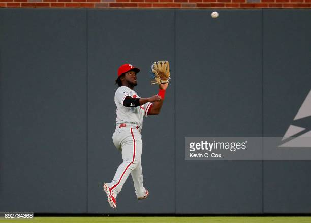 Odubel Herrera of the Philadelphia Phillies catches a line out hit by Tyler Flowers of the Atlanta Braves in the second inning at SunTrust Park on...