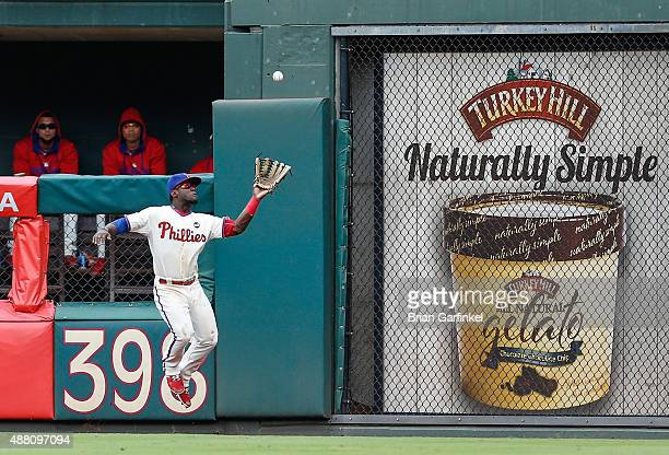 Odubel Herrera of the Philadelphia Phillies catches a long fly ball hit by Kyle Schwarber of the Chicago Cubs in the fifth inning of the game at...