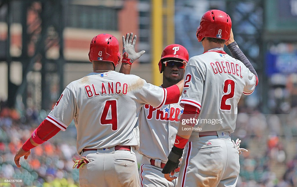 <a gi-track='captionPersonalityLinkClicked' href=/galleries/search?phrase=Odubel+Herrera&family=editorial&specificpeople=13795312 ng-click='$event.stopPropagation()'>Odubel Herrera</a> #37 of the Philadelphia Phillies celebrates after hitting a three run home run with his teammates <a gi-track='captionPersonalityLinkClicked' href=/galleries/search?phrase=Andres+Blanco&family=editorial&specificpeople=235346 ng-click='$event.stopPropagation()'>Andres Blanco</a> #4 and Tyler Goeddel #2 during the fourth inning of the inter-league game against the Detroit Tigers on May 25, 2016 at Comerica Park in Detroit, Michigan.