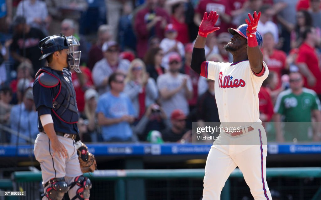 Odubel Herrera #37 of the Philadelphia Phillies celebrates in front of Kurt Suzuki #24 of the Atlanta Braves after hitting a solo home run in the bottom of the eighth inning at Citizens Bank Park on April 23, 2017 in Philadelphia, Pennsylvania. The Phillies defeated the Braves 5-2.