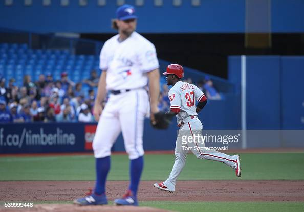 Odubel Herrera of the Philadelphia Phillies circles the bases after hitting a solo home run in the third inning during MLB game action as RA Dickey...