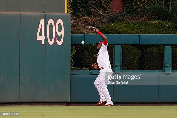 Odubel Herrera of the Philadelphia Phillies drops a fly ball at the warning track hit by Curtis Granderson of the New York Mets in the first inning...