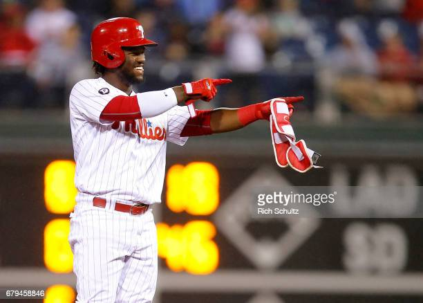 Odubel Herrera of the Philadelphia Phillies gestures after hitting an RBI double in the seventh inning against the Washington Nationals during a game...
