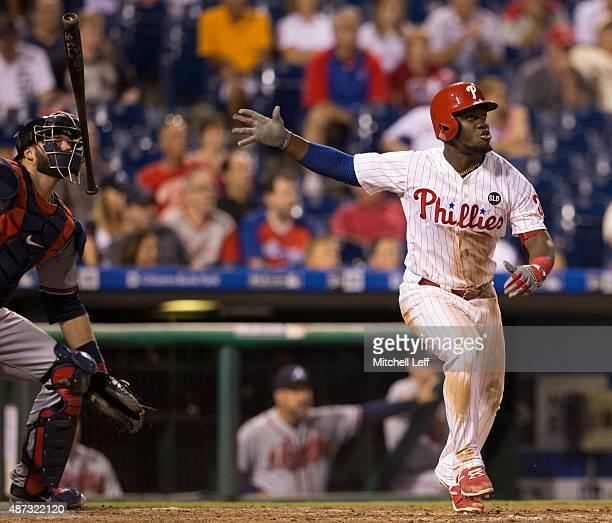 Odubel Herrera of the Philadelphia Phillies hits a threerun home run in the bottom of the eighth inning against the Atlanta Braves on September 8...