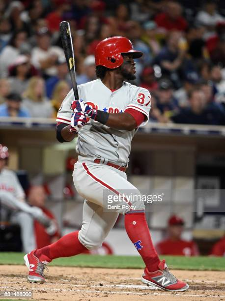 Odubel Herrera of the Philadelphia Phillies hits an RBI double during the third inning of a baseball game against the San Diego Padres at PETCO Park...