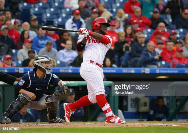 Odubel Herrera of the Philadelphia Phillies hits an RBI double in the first inning during a game against the Seattle Mariners at Citizens Bank Park...