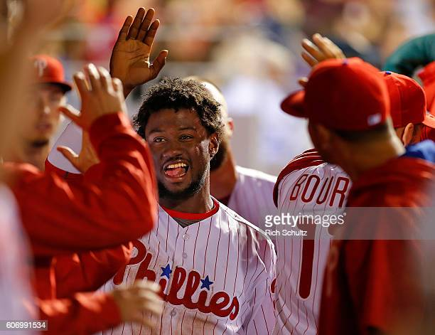 Odubel Herrera of the Philadelphia Phillies is congratulated after scoring on a fielder's choice by Aaron Altherr against the Miami Marlins during...