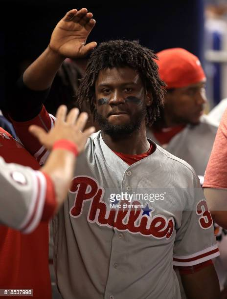 Odubel Herrera of the Philadelphia Phillies is congratulated after scoring during a game against the Miami Marlins at Marlins Park on July 18 2017 in...