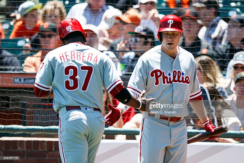 <a gi-track='captionPersonalityLinkClicked' href=/galleries/search?phrase=Odubel+Herrera&family=editorial&specificpeople=13795312 ng-click='$event.stopPropagation()'>Odubel Herrera</a> #37 of the Philadelphia Phillies is congratulated by <a gi-track='captionPersonalityLinkClicked' href=/galleries/search?phrase=Cody+Asche&family=editorial&specificpeople=10524550 ng-click='$event.stopPropagation()'>Cody Asche</a> #25 after scoring a run against the San Francisco Giants during the first inning at AT&T Park on June 26, 2016 in San Francisco, California.