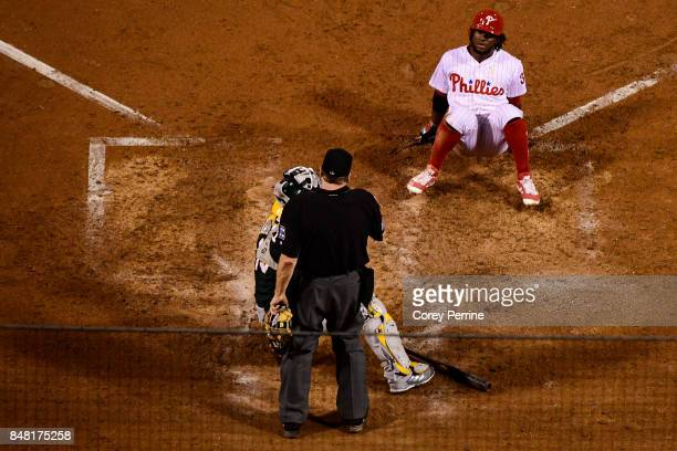 Odubel Herrera of the Philadelphia Phillies is hit by a pitch against the Oakland Athletics during the eighth inning at Citizens Bank Park on...